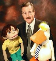 Performer Mike Randall (USA) with BENNY puppet.