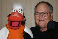 Performer Garry Lenon with DUCK puppet .